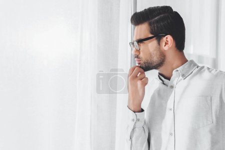 Photo for Side view of thoughtful handsome businessman looking away - Royalty Free Image