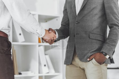 Photo for Cropped image of african american businessman and colleague shaking hands - Royalty Free Image