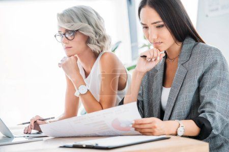 Photo for Beautiful multicultural businesswomen working in office - Royalty Free Image