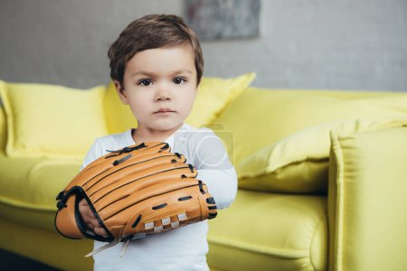 adorable little boy playing with baseball glove