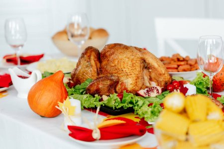 selective  focus of baked turkey on served table for thanksgiving dinner