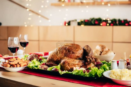 selective focus of baked turkey on served table for holiday dinner