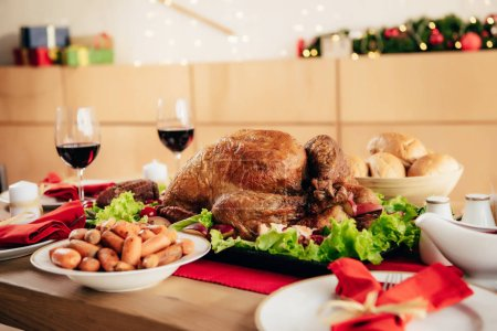 Photo for Served table with delicious dishes and wine for thanksgiving dinner - Royalty Free Image