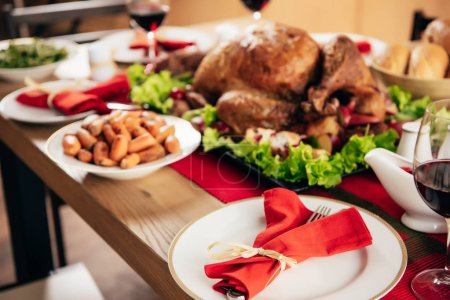 selective focus of served table with wine and delicious dishes for christmas dinner