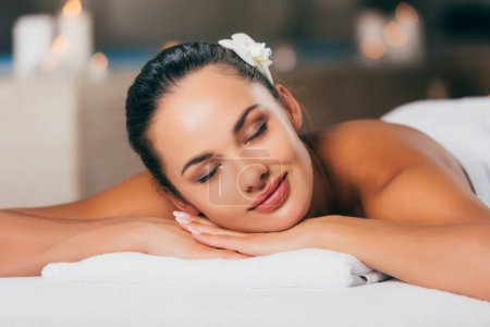 happy woman relaxing at massage salon