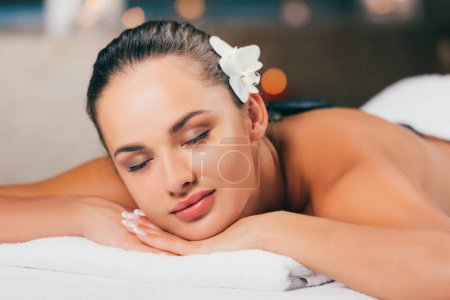 young brunette woman relaxing at spa salon