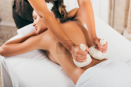 beautiful young woman receiving treatment at spa salon