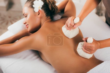 young woman receiving treatment at spa salon