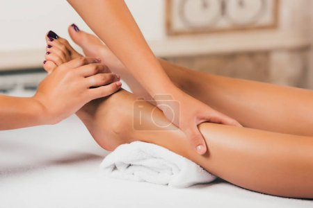 Photo for Cropped view of woman having feet massage therapy in spa salon - Royalty Free Image