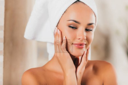 gorgeous woman in bath robe with perfect clean face