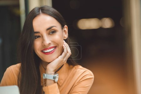 Photo for Selective focus of dreamy happy woman looking away in cafe - Royalty Free Image