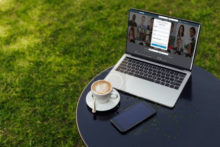 laptop with loaded linkedin page on table in garden