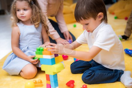 Photo for Adorable kids playing with constructor in kindergarten - Royalty Free Image