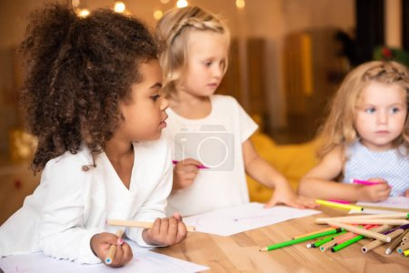 Photo for Multicultural kids drawing together in kindergarten - Royalty Free Image