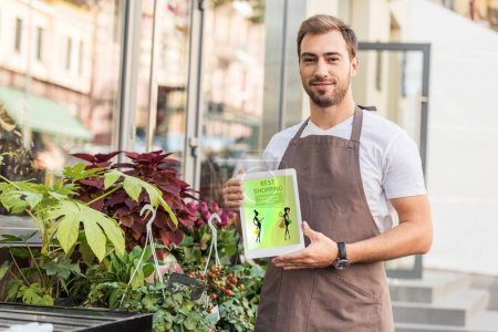 handsome florist holding tablet with best shopping appliance near flower shop