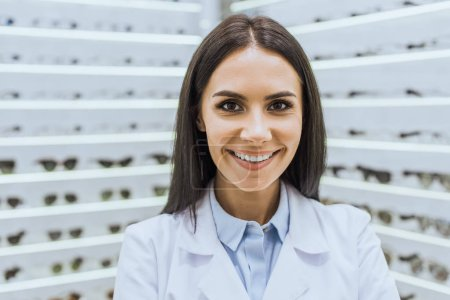 Photo for Professional smiling optometrist in white coat looking at camera - Royalty Free Image