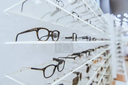 Photo for Selective focus of white shelves with stylish glasses in ophthalmology - Royalty Free Image