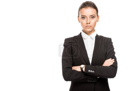 young businesswoman in jacket looking at camera with crossed arms isolated on white