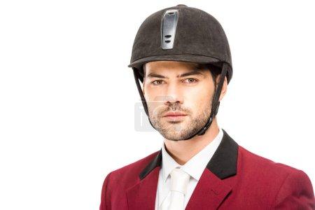 Foto de Primer plano retrato de caballero joven apuesto en uniforme y casco mirando a cámara aislada en blanco - Imagen libre de derechos