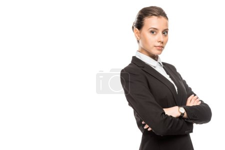Photo for Beautiful young businesswoman in suit looking at camera with crossed arms isolated on white - Royalty Free Image