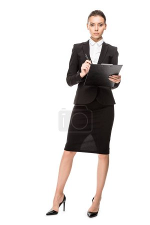 Photo for Attractive young businesswoman in suit with clipboard looking at camera isolated on white - Royalty Free Image