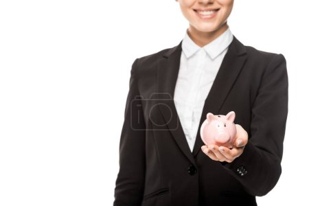 cropped shot of smiling businesswoman holding piggy bank isolated on white