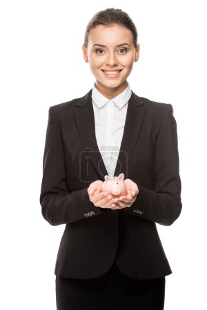happy young businesswoman holding piggy bank isolated on white