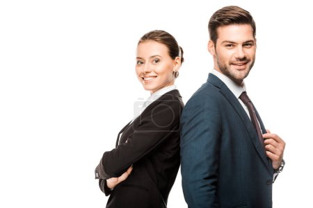 happy young business partners leaning back to back and looking at camera isolated on white