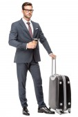 handsome young businessman with luggage and paper cup of coffee looking away isolated on white