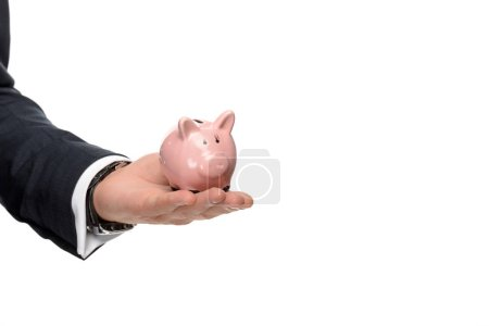 cropped image of businessman holding pink piggybank isolated on white