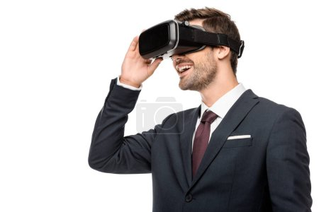 happy young businessman using virtual reality headset isolated on white