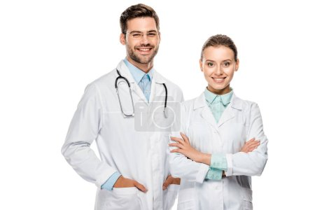 Photo for Handsome happy male doctor standing near female colleague with crossed arms isolated on white - Royalty Free Image