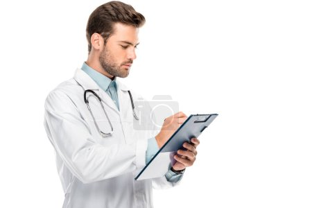 side view of male doctor with stethoscope over neck writing in clipboard isolated on white
