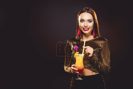 brunette glamorous smiling girl with alcohol cocktail on black