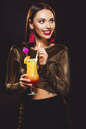 cheerful glamorous girl with alcohol cocktail on black
