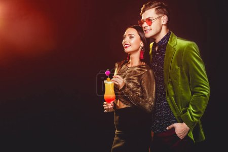 beautiful glamorous couple with cocktail on party