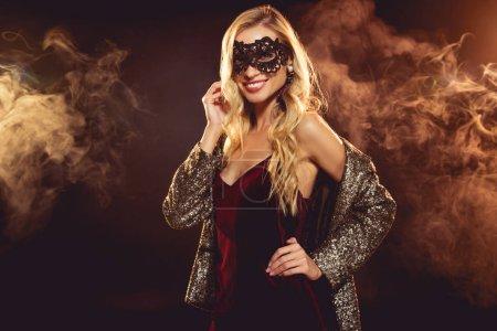 beautiful blonde glamorous girl in carnival mask