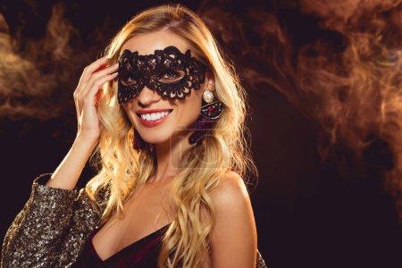 happy beautiful blonde girl in carnival mask