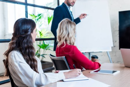 Photo for Partial view of businessman and businesswomen having meeting in office - Royalty Free Image