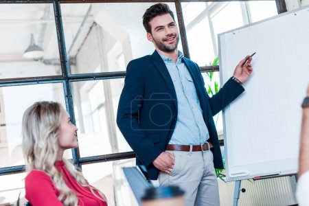Photo for Young businesspeople having meeting in office - Royalty Free Image