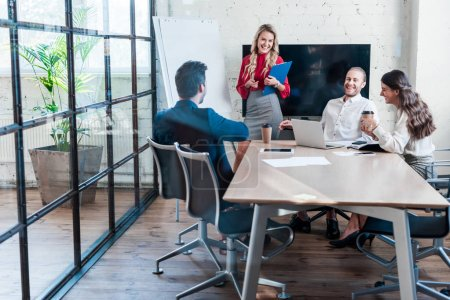 Photo for Cheerful businesspeople having meeting in office - Royalty Free Image