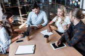 young business coworkers discussing project during meeting in office