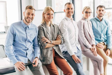 happy professional young start up team smiling at camera in office