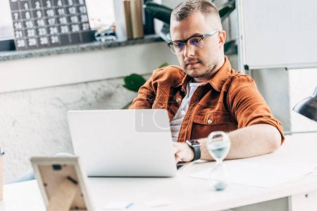Photo for Handsome businessman working with laptop at modern office - Royalty Free Image