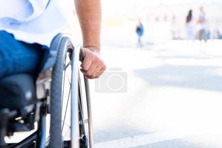 Photo for Cropped image of disabled man using wheelchair on street - Royalty Free Image