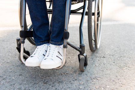 Photo for Cropped image of man using wheelchair on street - Royalty Free Image