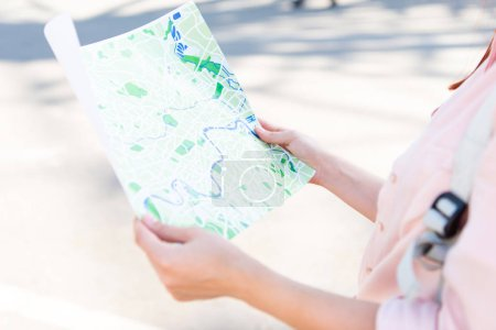 Photo for Cropped image of tourist holding city map on street - Royalty Free Image