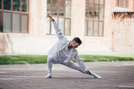 Photo for Handsome active young man dancing on urban city street - Royalty Free Image