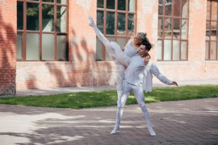 young dancers performing ballet on urban city street
