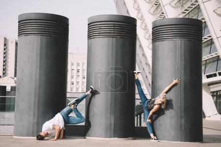 Photo for Young contemporary dancers practicing on urban city street - Royalty Free Image